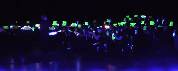 Paper Cut in black light performance.
