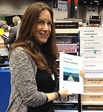 Alexwith some of her music at the Hal Leonard rack at the Midwest Clinic, 2014.
