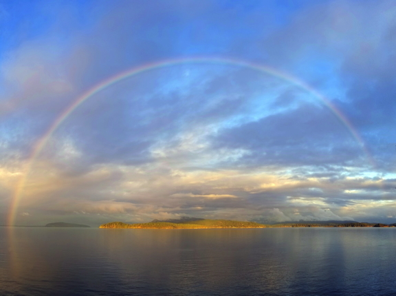 A full rainbow, photographed by Alex from her studio deck.
